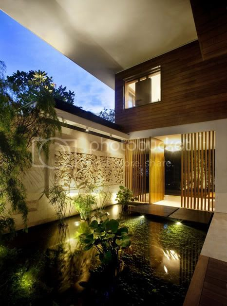 amazing villa Freshome 09 Meera House: a house in singapore with green roof and transparent swimming pool